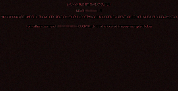 Desktop wallpaper set by GandCrab 5.1.0 with the warning message plus reference to ransom note