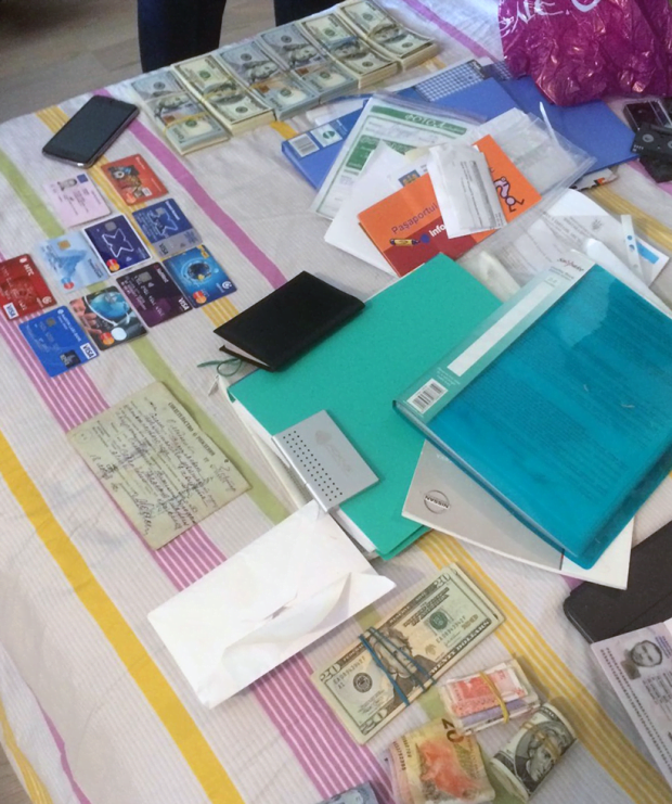 The seized cash, credit cards, IDs, financial documentation and more